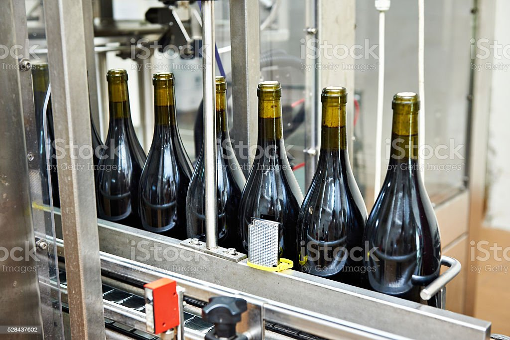 Bottling and sealing conveyor line at wine factory stock photo