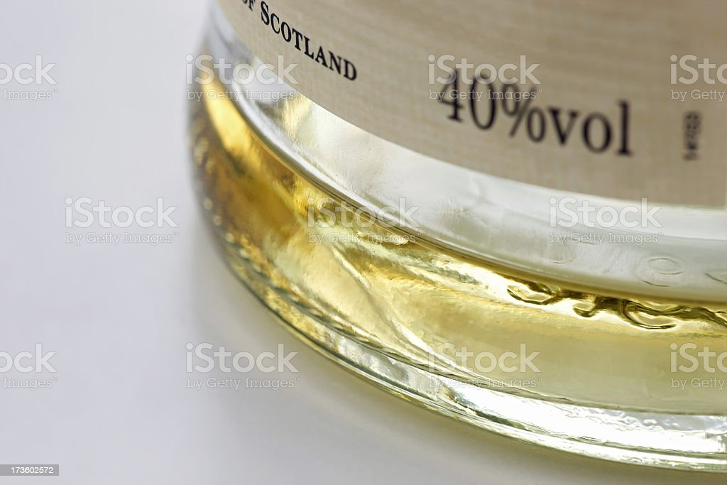 Bottle of Scotch, almost empty stock photo