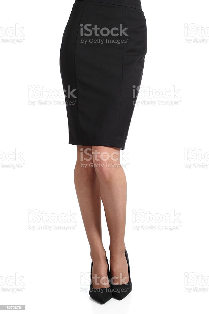 Bottom half of woman wearing pencil skirt on white stock photo