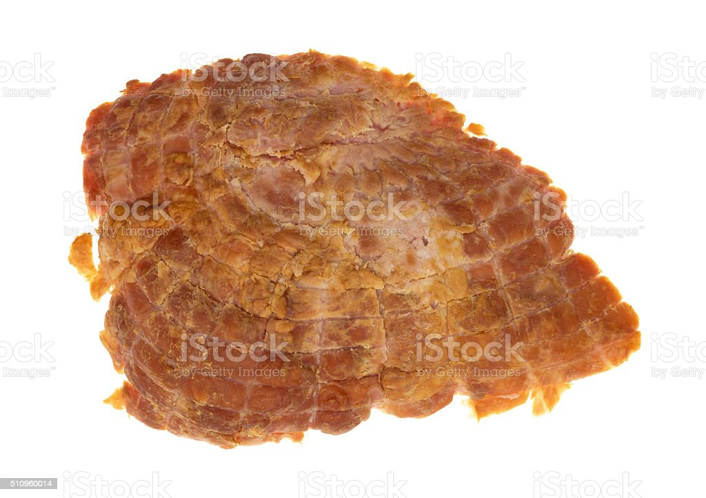Bottom of a baked ham end isolated on white background stock photo