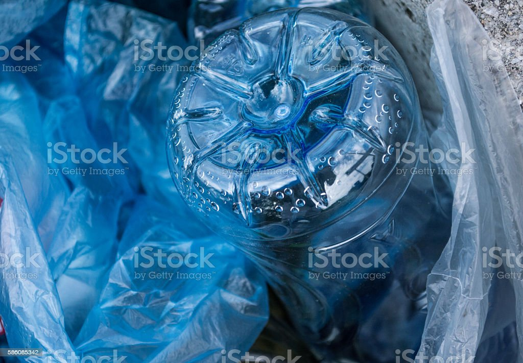 Bottom of a Plastic Drink Bottle in a Bin/Trash Can royalty-free stock photo