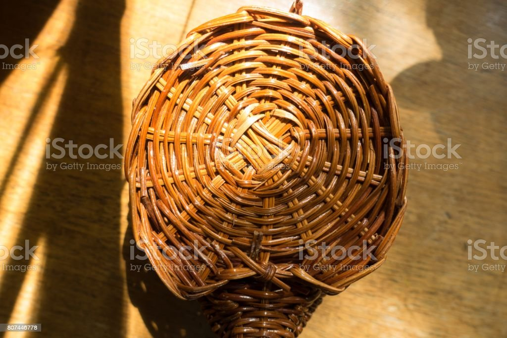 Bottom of brown wicker basket from above stock photo