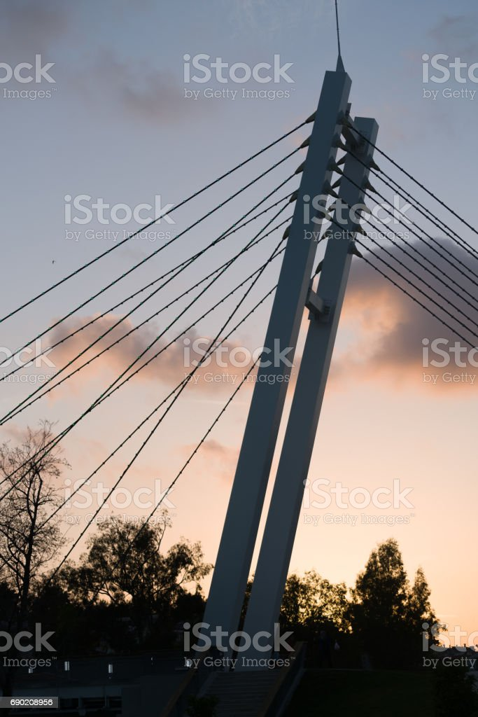 Bottom view of modern bridge arch detail with sunset. stock photo