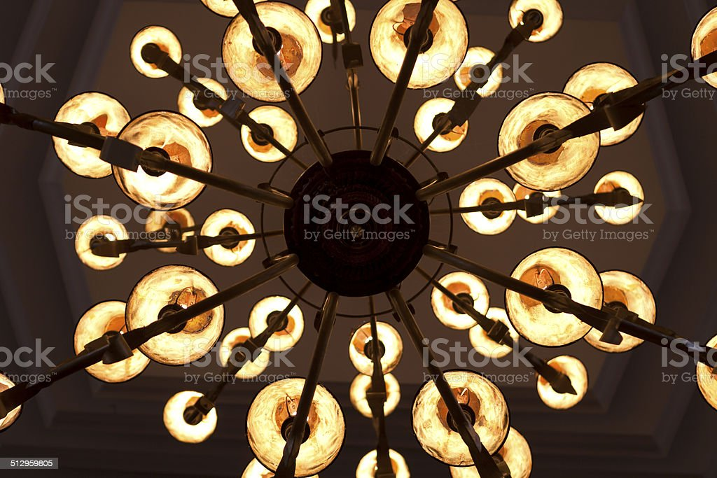 bottom view of vintage chandelier, abstract wallpaper stock photo