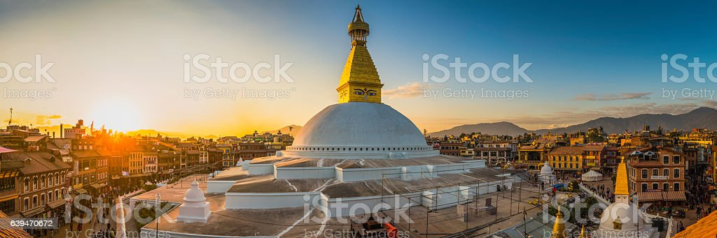 Boudhanath iconic Buddhist stupa and pilgrims at sunset Kathmandu Nepal stock photo