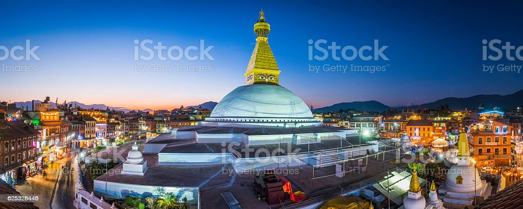 Boudhanath Stupa iconic Buddhist temple illuminated at sunset Kathmandu Nepal stock photo