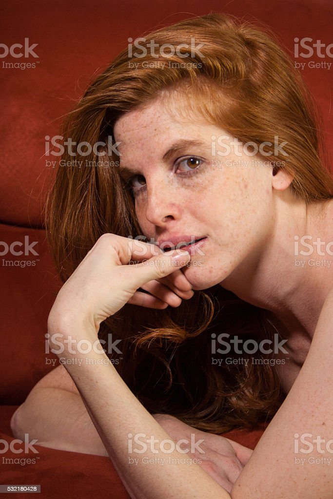 Boudoir Photo of Real Woman with Freckles and Red Hair stock photo
