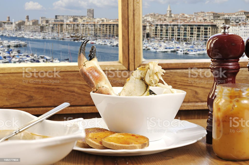 Bouillabaisse with view of Marseille royalty-free stock photo