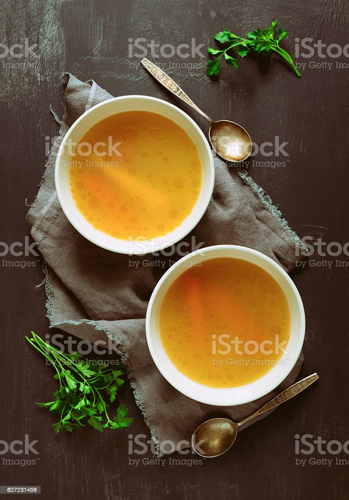 Bouillon served in two bowls stock photo