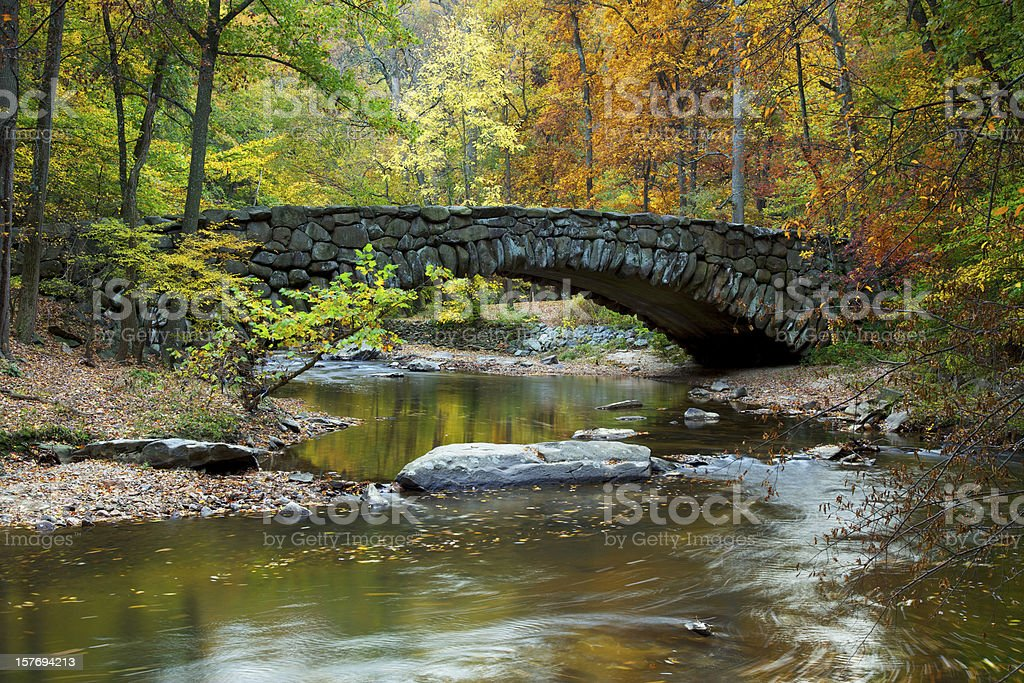 Boulder Bridge in Rock Creek Park on an autumn day stock photo