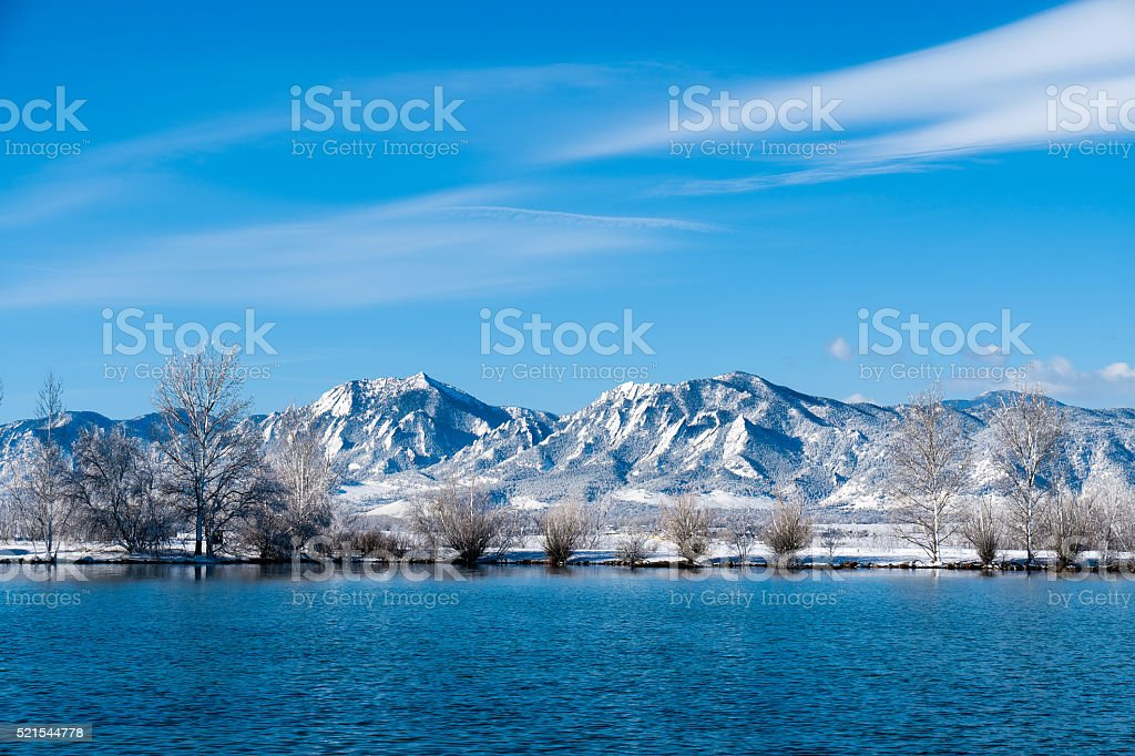 Boulder Flatirons and winter snow stock photo