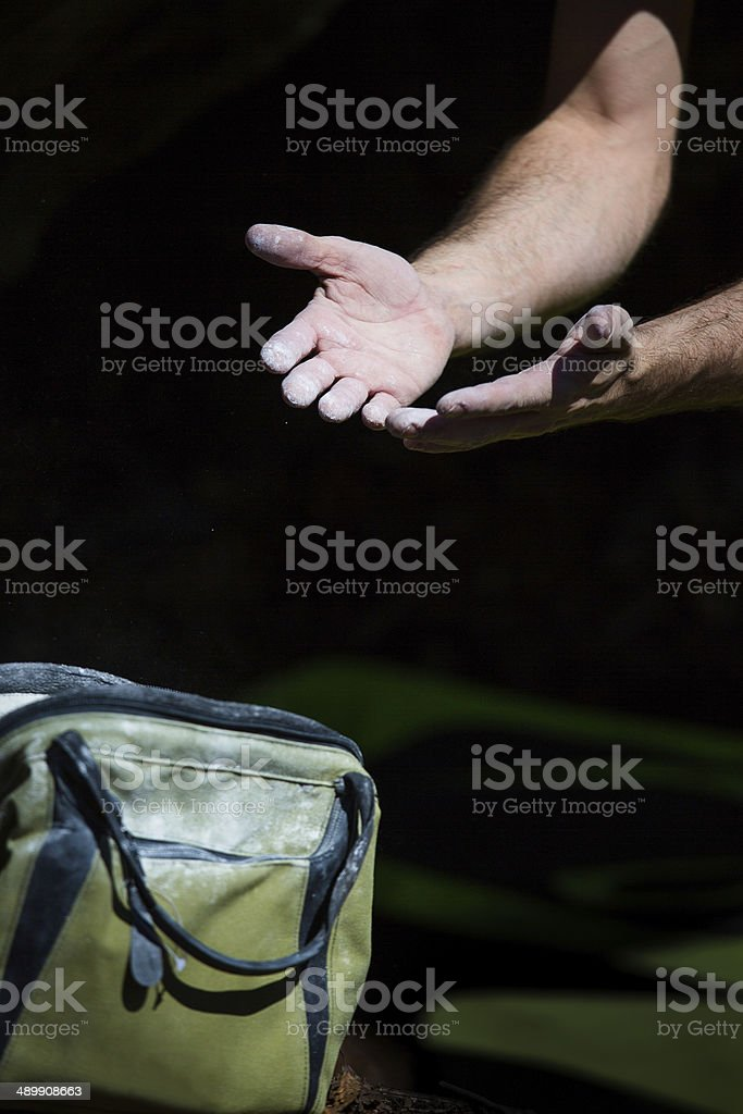 boulderers hands covered by magnesium stock photo