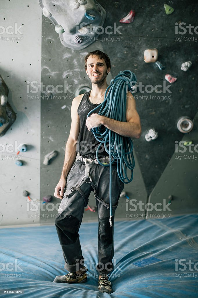 Bouldering climber portrait looking at camera in the gym. stock photo