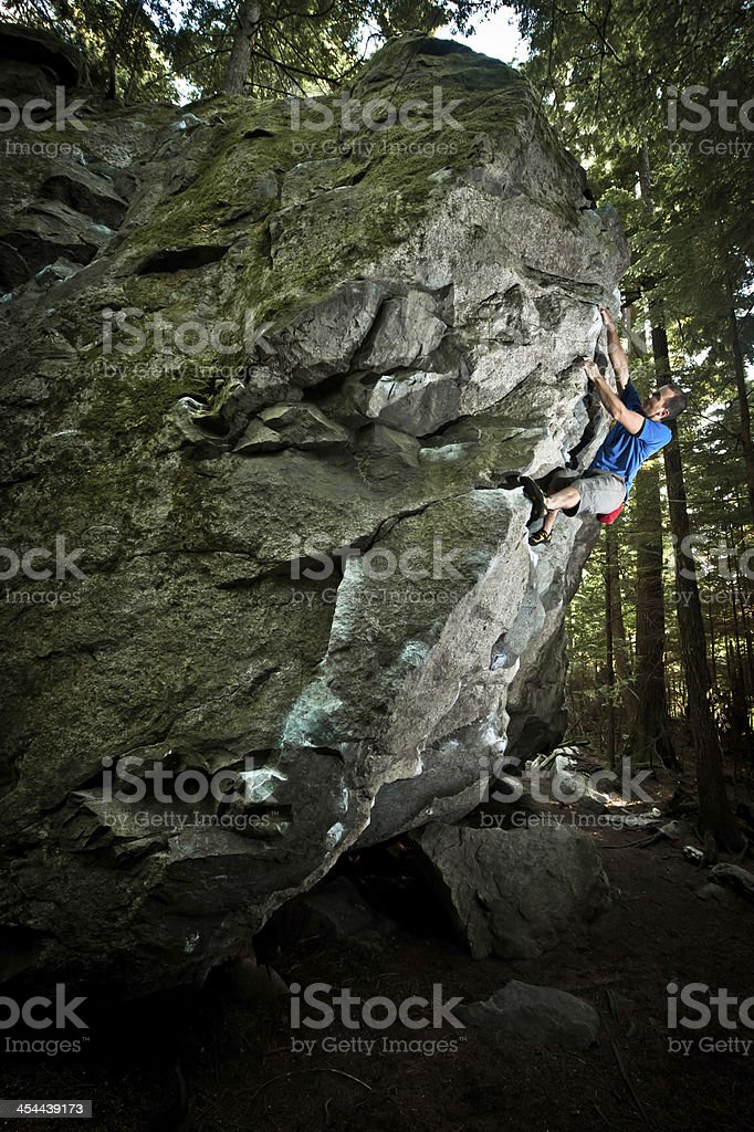Bouldering in the forest royalty-free stock photo