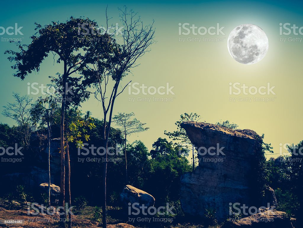 Boulders against beautiful sky and full moon over tranquil natur stock photo