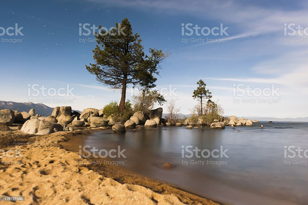 Boulders and beach at Lake Tahoe during night royalty-free stock photo