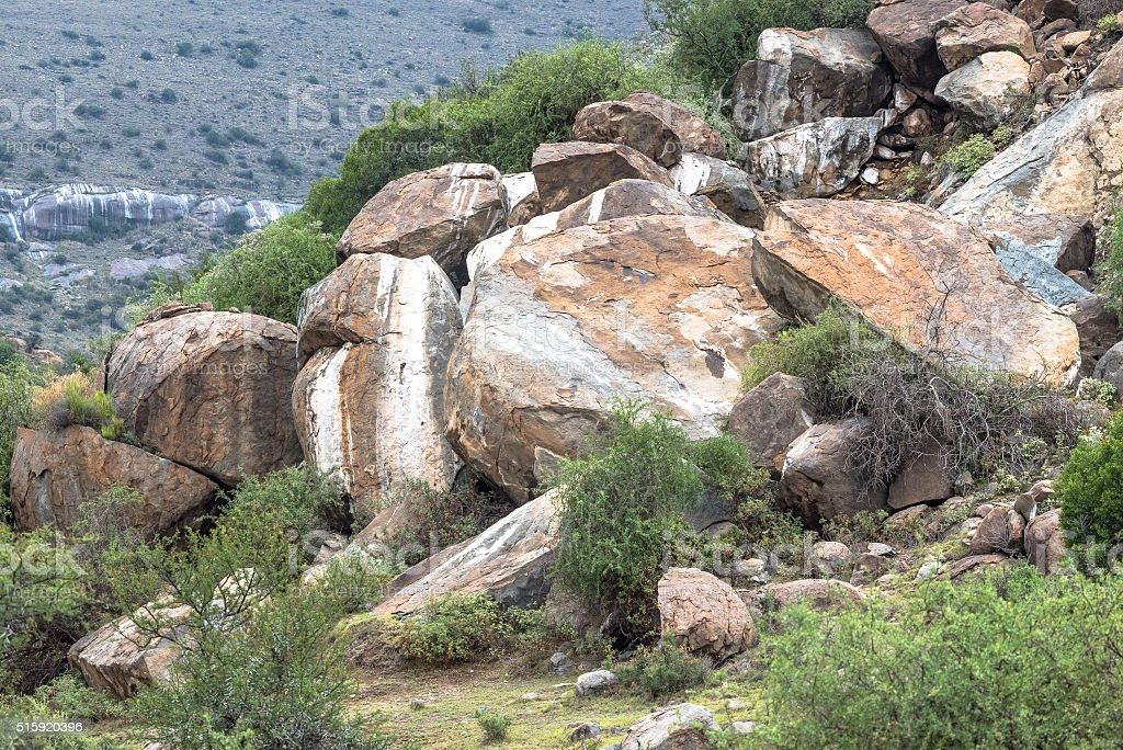 Boulders coloured white by rock hyrax urine stock photo