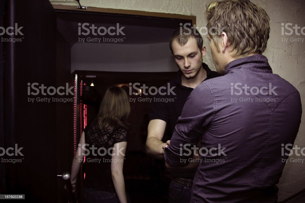 bouncer checking people at the nightclub stock photo