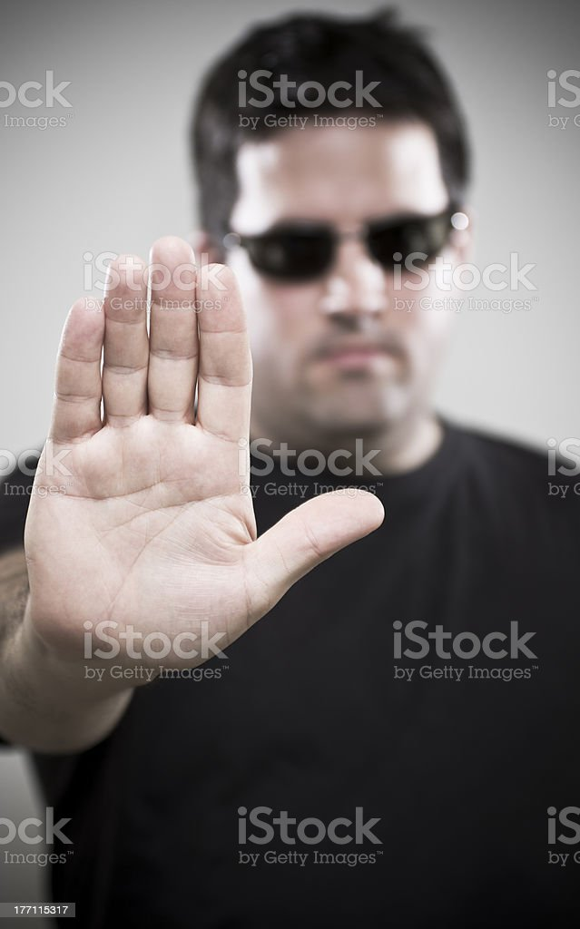 Bouncer makes Stop gesture royalty-free stock photo