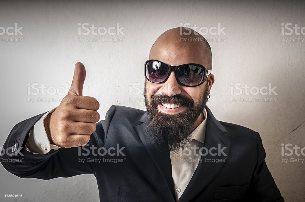 bouncer with jacket and sunglasses stock photo
