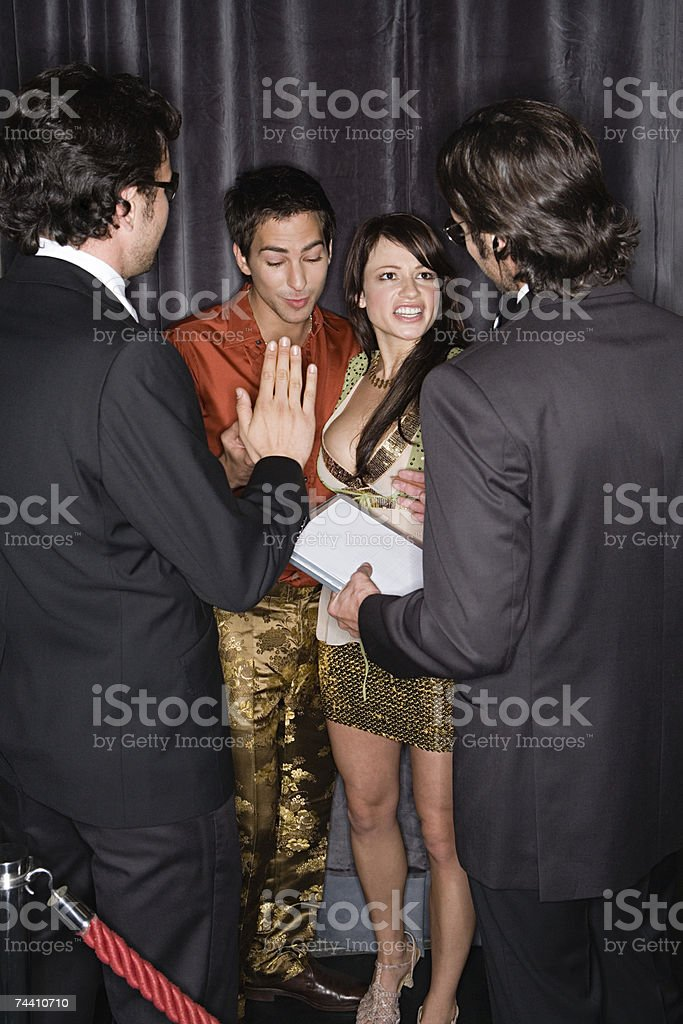 Bouncers stopping a couple stock photo