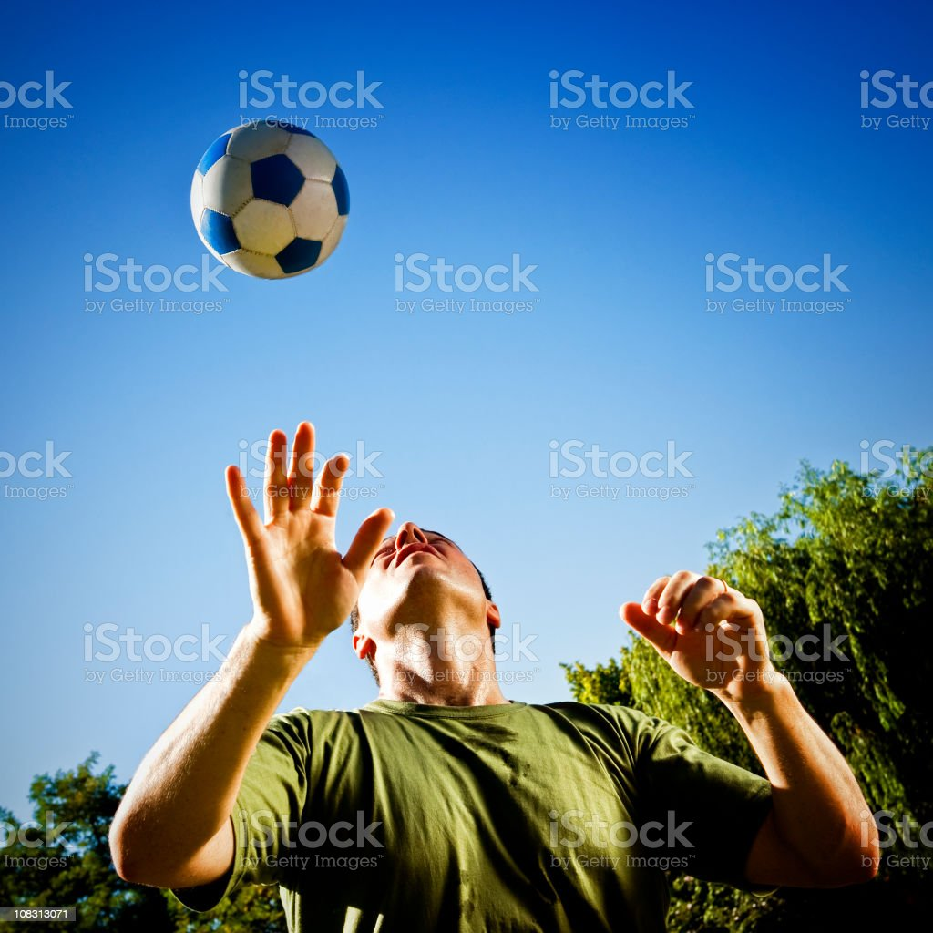Bouncing soccer ball off head royalty-free stock photo