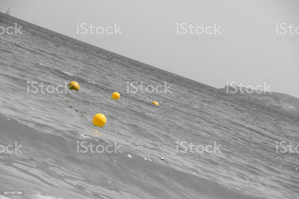 Boundary mark floats on sea water's surface. stock photo