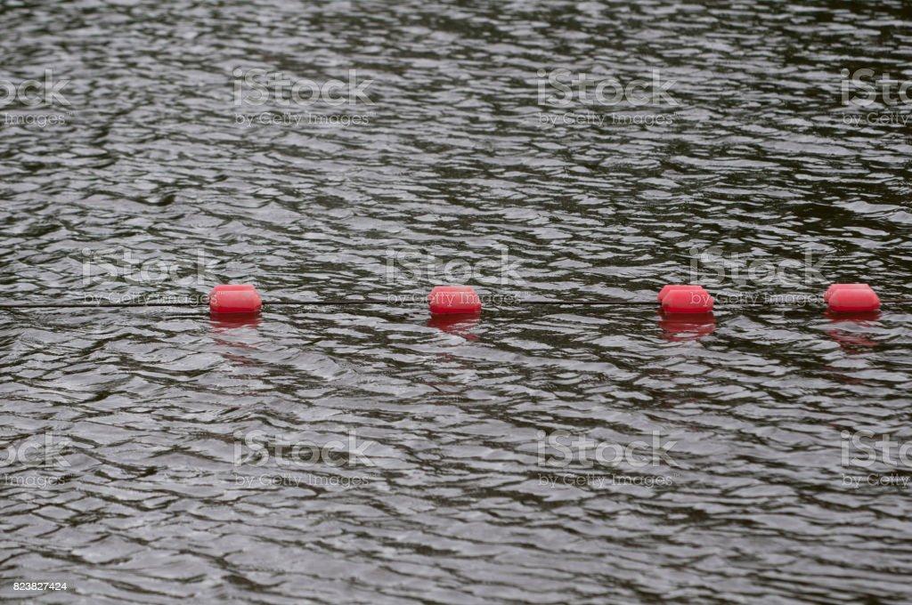 Boundary mark floats on sea water's surface stock photo