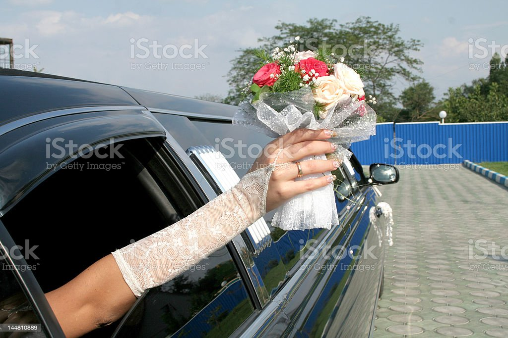 bouqet of bride from the limousine window royalty-free stock photo