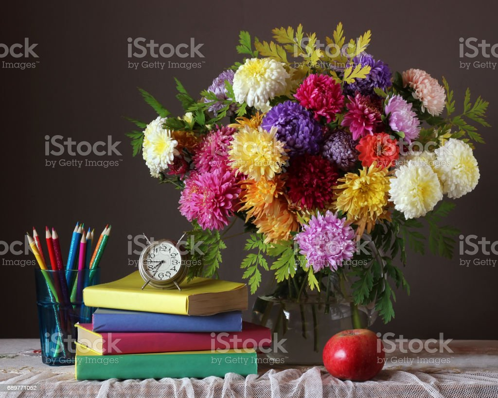 Bouquet and book. Back to school. September 1. stock photo