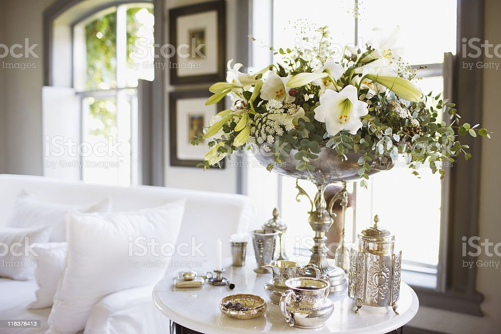Bouquet and silver on living room table stock photo