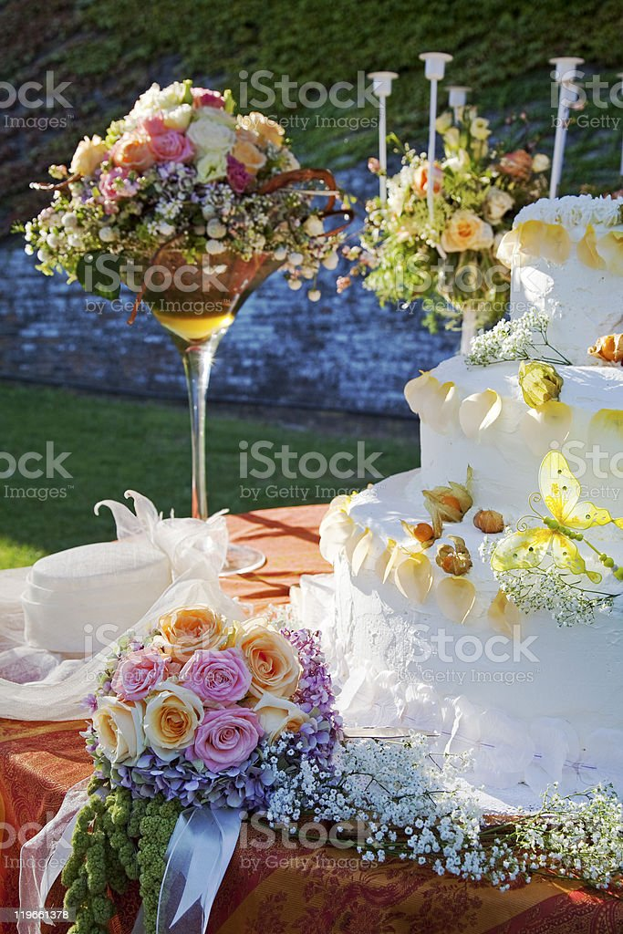 Bouquet and wedding cake. royalty-free stock photo