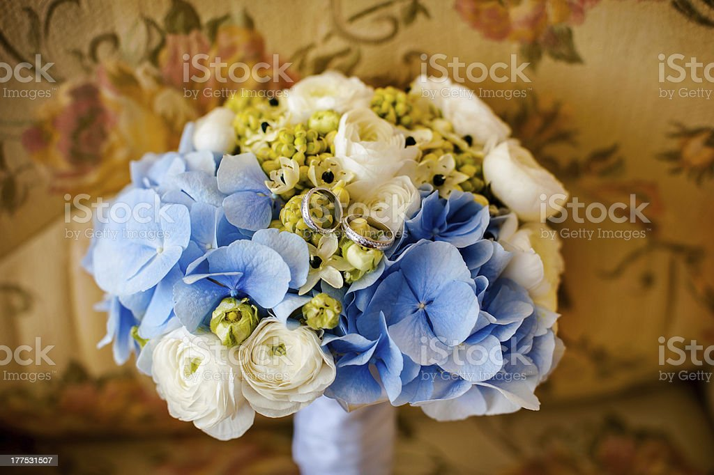 Bouquet and wedding rings royalty-free stock photo