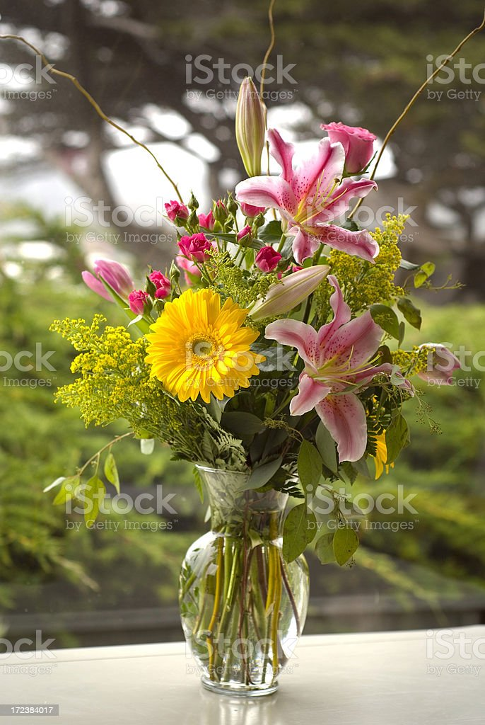 Bouquet Arrangement of Assorted Spring Flowers Bunch Vase on Table royalty-free stock photo
