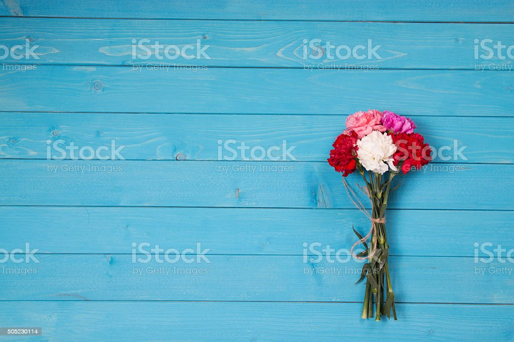 bouquet flower on blue background stock photo