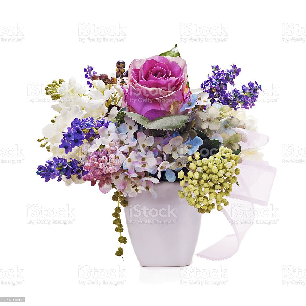 Bouquet from artificial flowers arrangement centerpiece in vase royalty-free stock photo