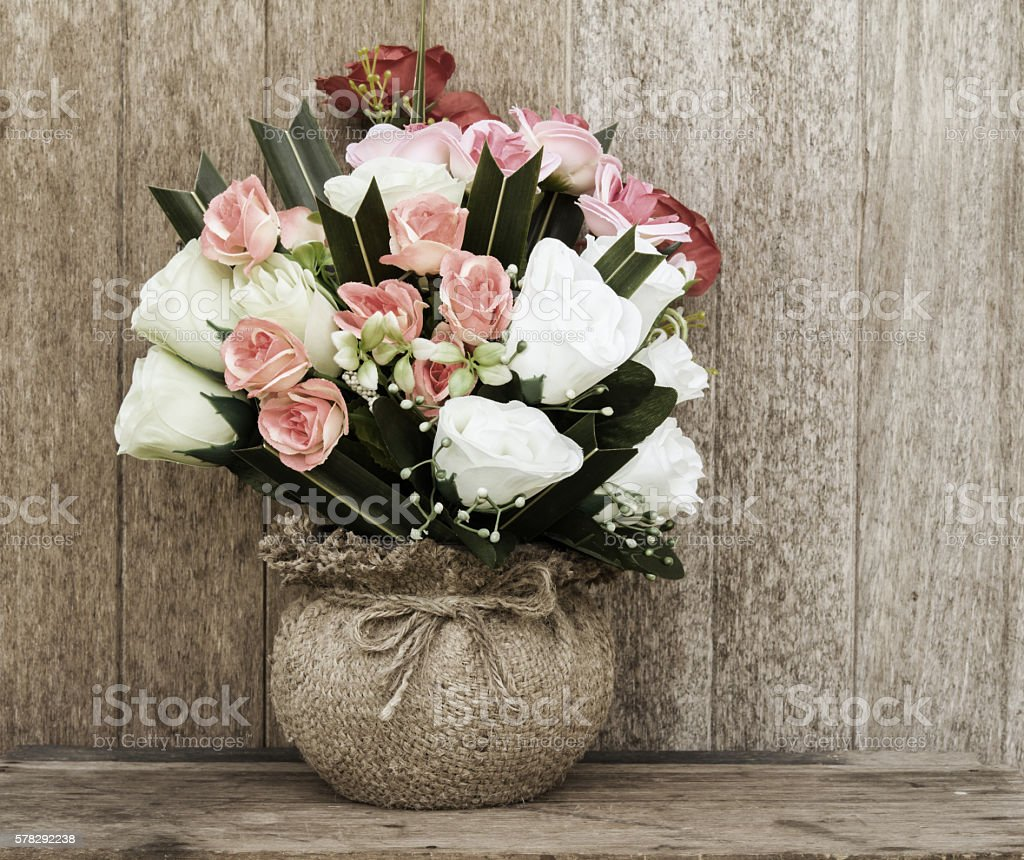 Bouquet in Vase on wood table stock photo