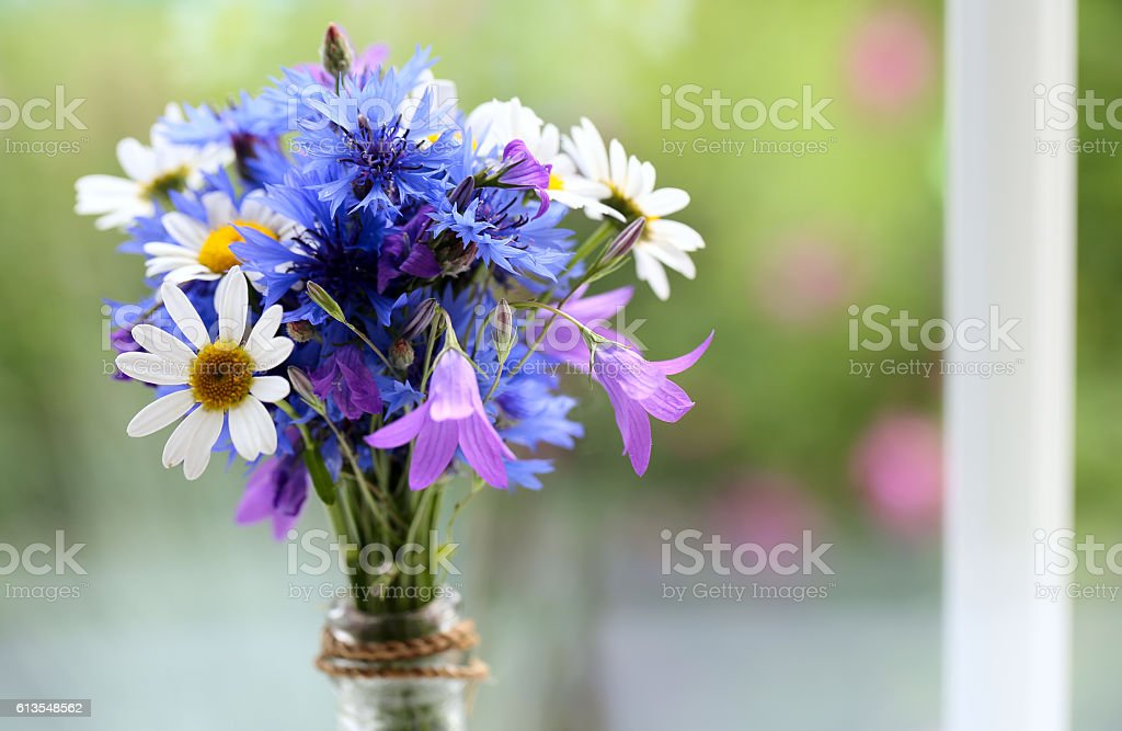 bouquet made of wildflowers on windowsill stock photo