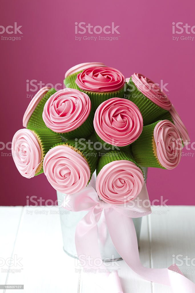 Bouquet made up of pink iced cupcakes royalty-free stock photo