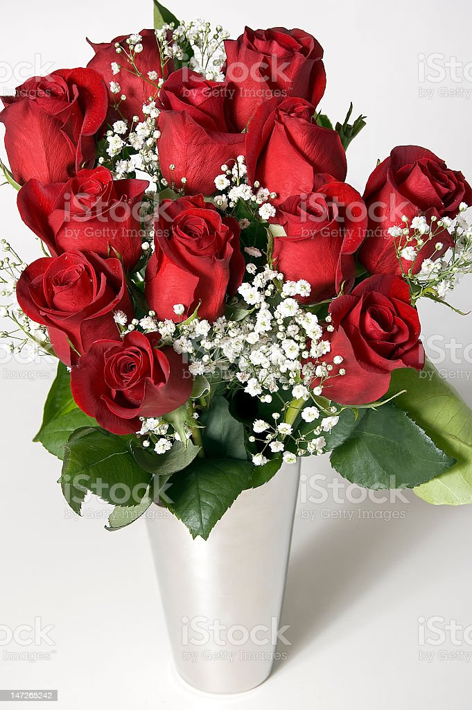 Bouquet of A Dozen Red Roses in Flower Vase stock photo