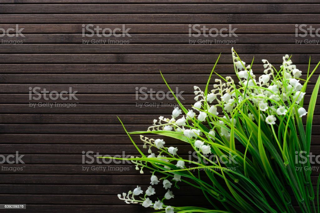 Bouquet of artificial lilies the valley stock photo