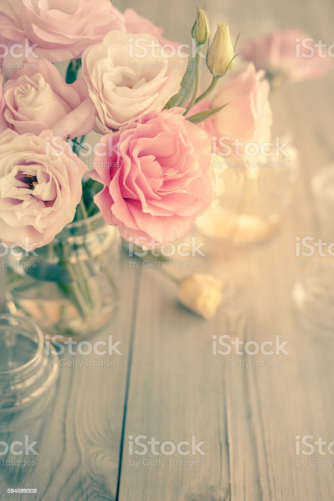 Bouquet of beautiful pink flowers on old wooden texture stock photo