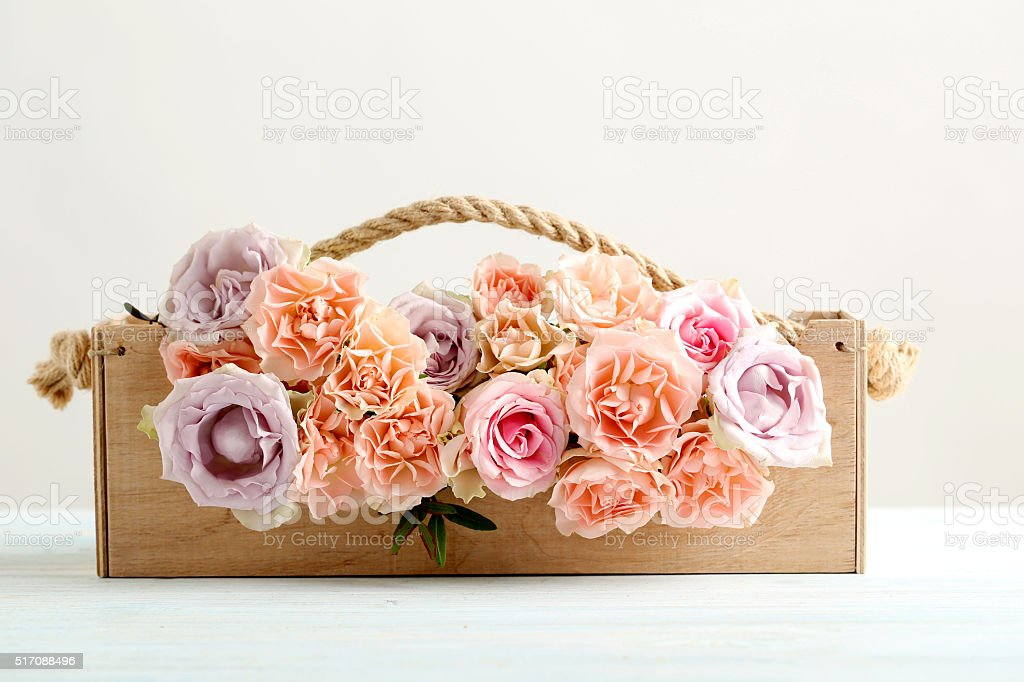 Bouquet of beautiful roses on a blue wooden table stock photo