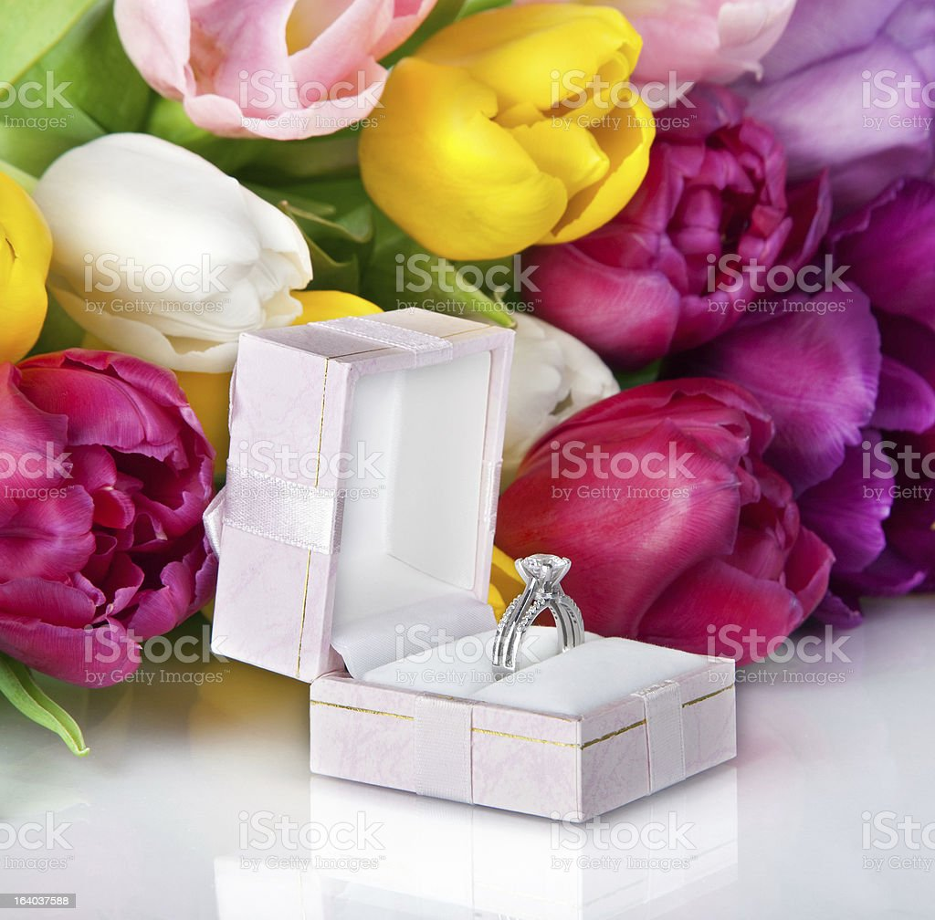 Bouquet of beautiful tulips flowers and wedding ring royalty-free stock photo