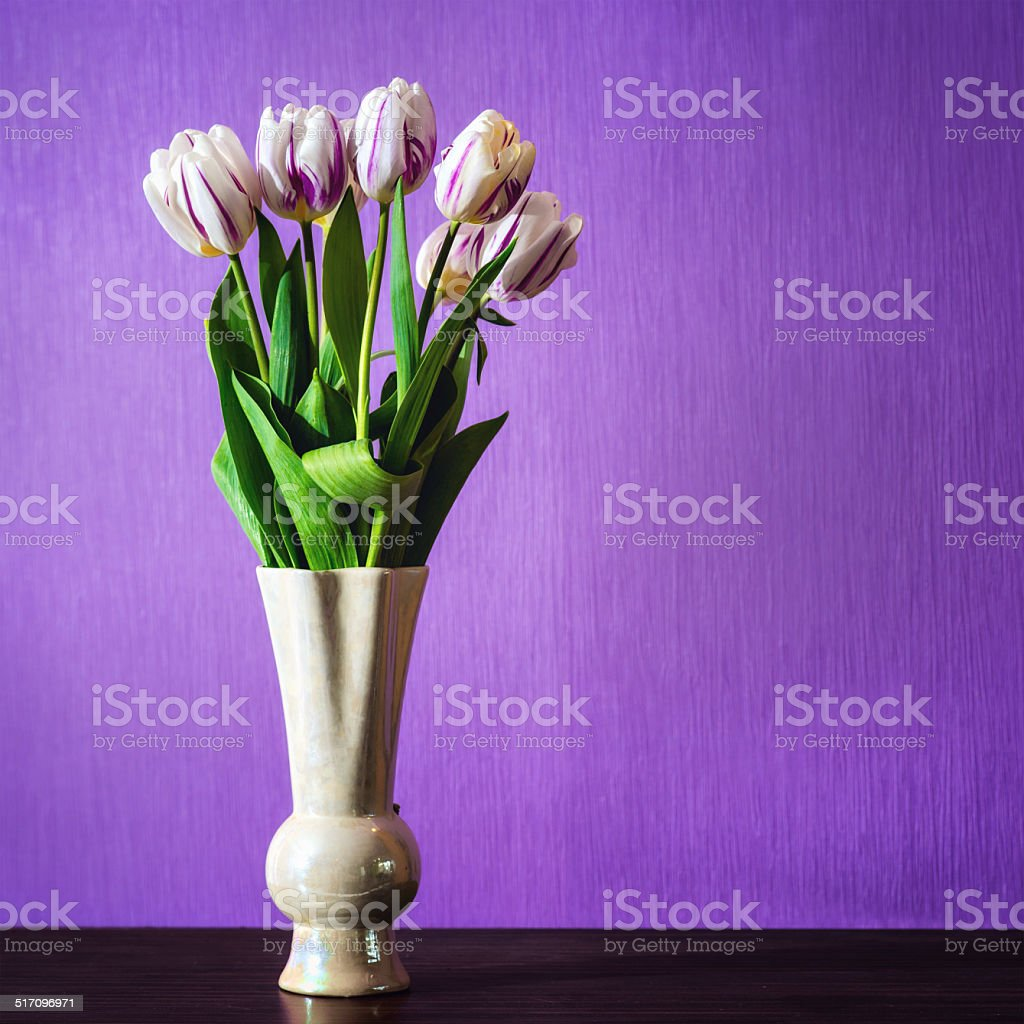 Bouquet of beautiful tulips flowers in vase on table stock photo