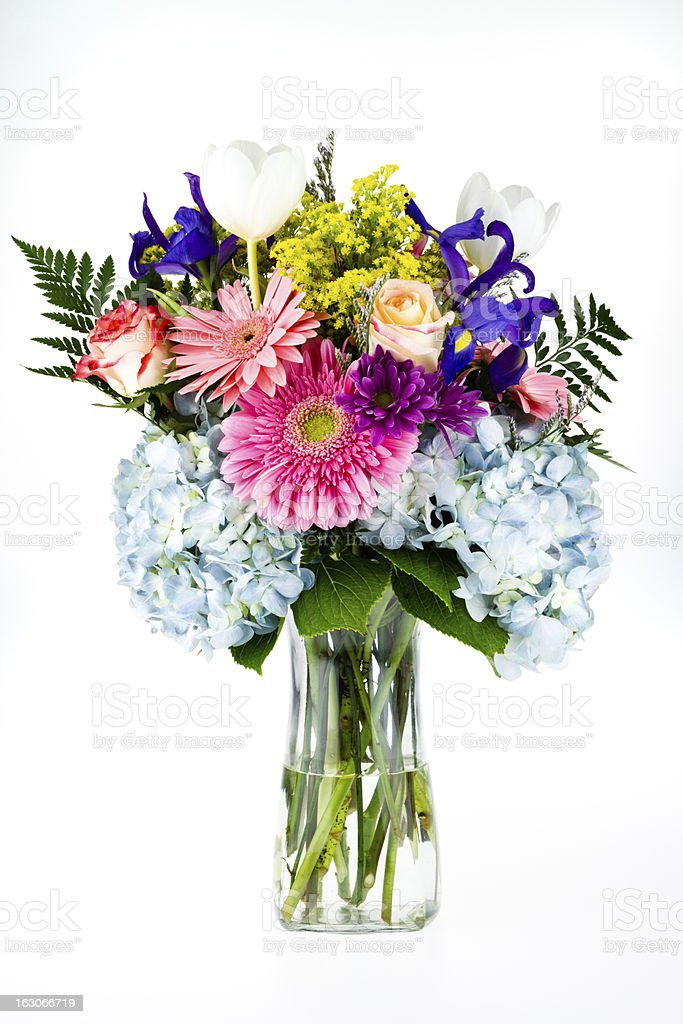 Bouquet of colorful flowers in a glass vase. stock photo