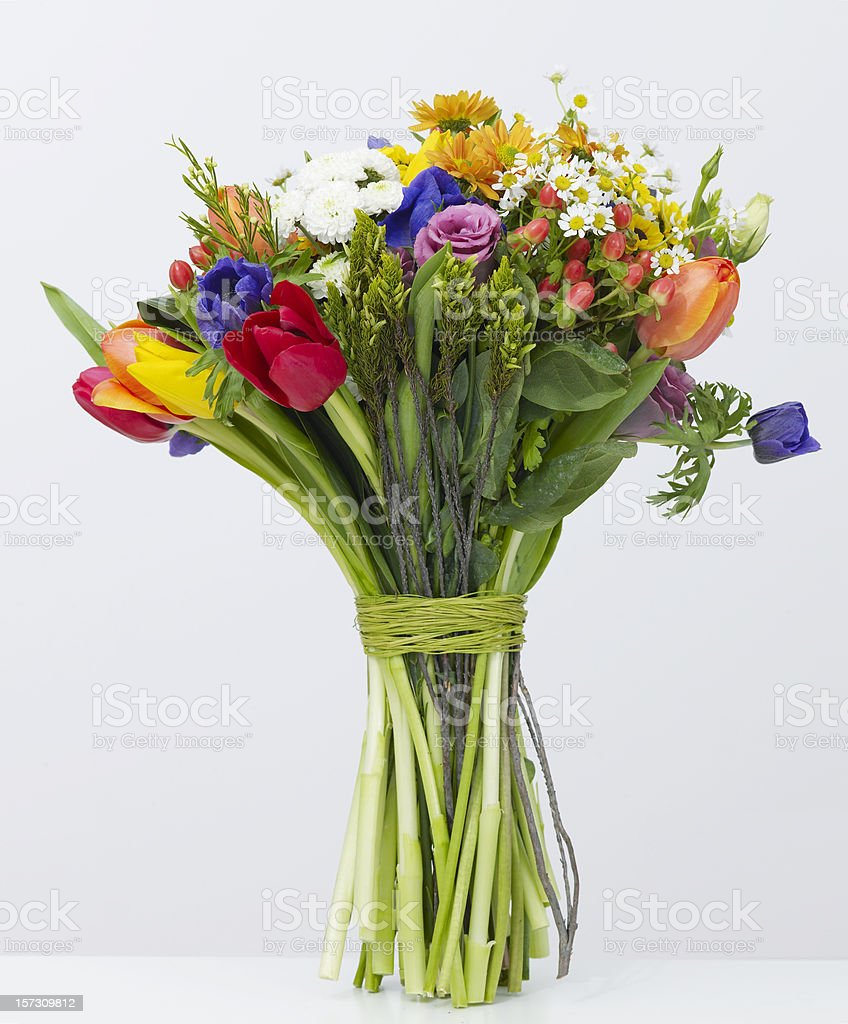 Bouquet of colorful flowers tied with green twine royalty-free stock photo