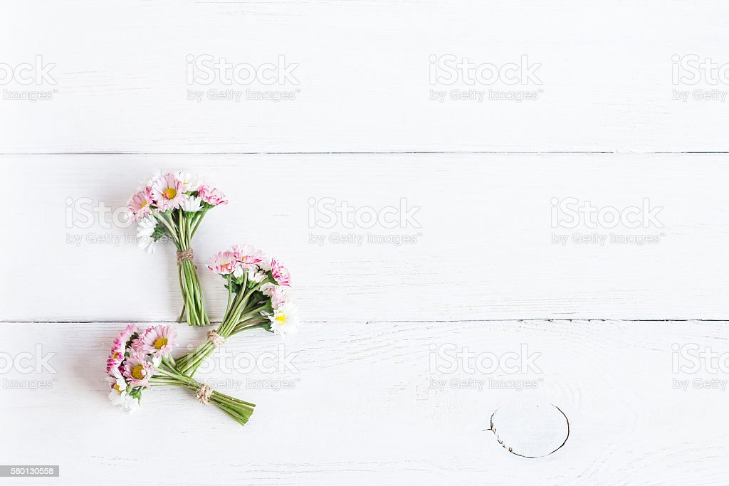 bouquet of daisy flowers, top view, flat lay stock photo