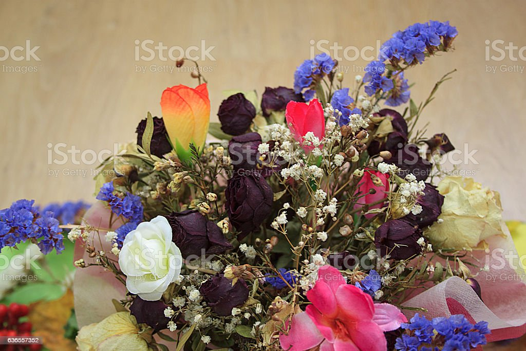 Bouquet of dried flowers for wedding on wooden table.