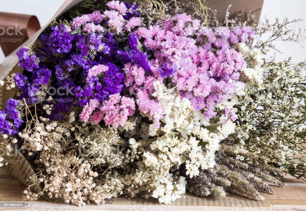 Bouquet of dried flowers on the wooden table stock photo